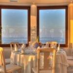 Pyrgos Restaurant Santorini Weddings Veranda Panorama inside Sunset