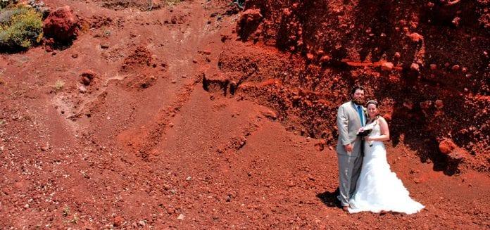 Santorini Weddings couple red volcano